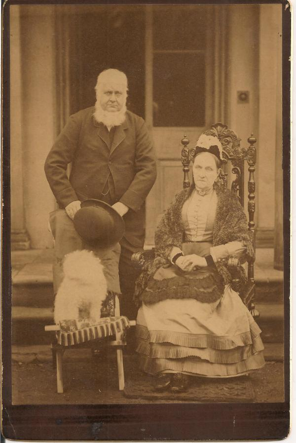 This grim couple are my a few greats-relatives.  And their little white fluffy dog.