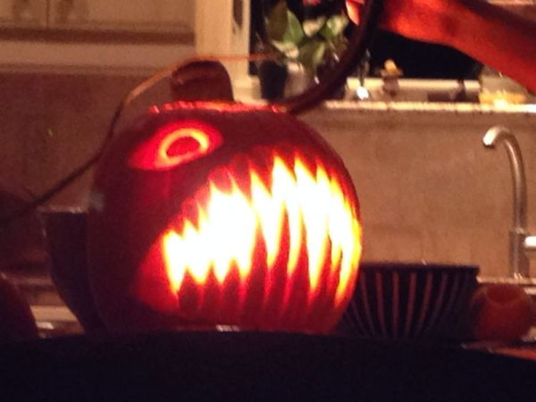 my pumpkin from this year - tonight, he'll have a glowy tiny pumpkin hanging over his slightly baffled angler-fish face